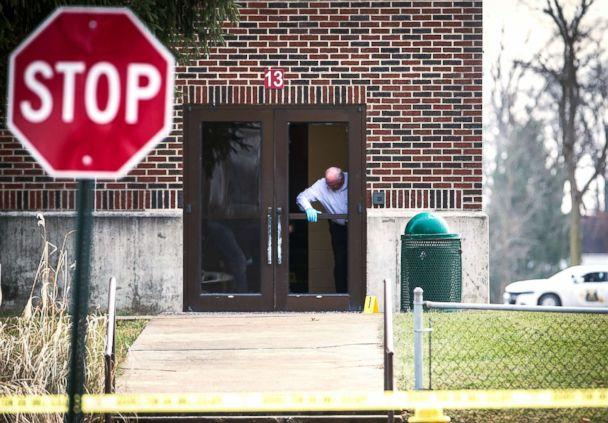 PHOTO: Investigators examine a a door at Dennis Intermediate School where a shooter allegedly broke the glass to enter the building in Richmond, Ind., Dec. 13, 2018. (Jordan Kartholl/The Star Press via US Today Nework)
