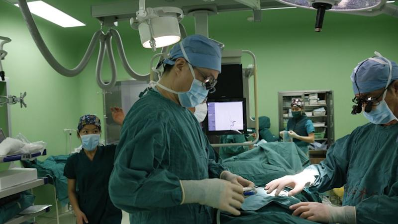 Cardiovascular surgeons prepare for a surgery at a hospital in Beijing