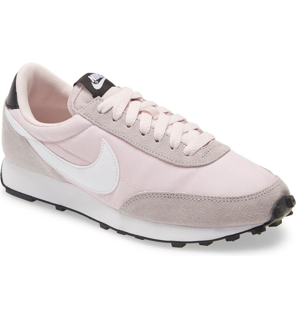 <p>These cool <span>Nike Daybreak Sneakers</span> ($90) will take your outfit to the next level.</p>