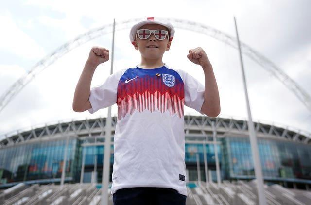A young England fan outside the ground