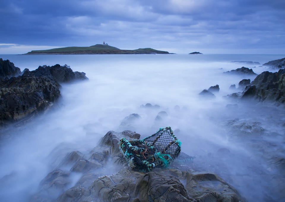 <p>Fog drifts from the cliffs onto the waters in the Seaside resort of Ballycotton, Ireland. (Dave Keeley)</p>