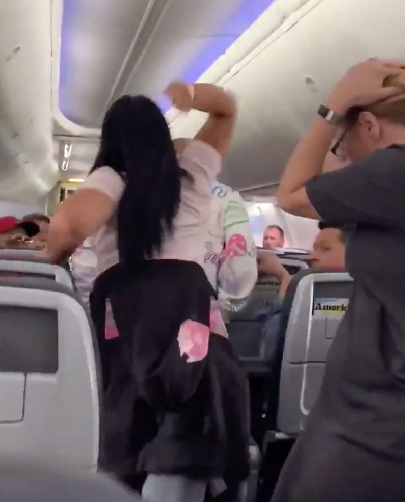 Woman removed from American Airlines flight after smashing laptop on partner's head