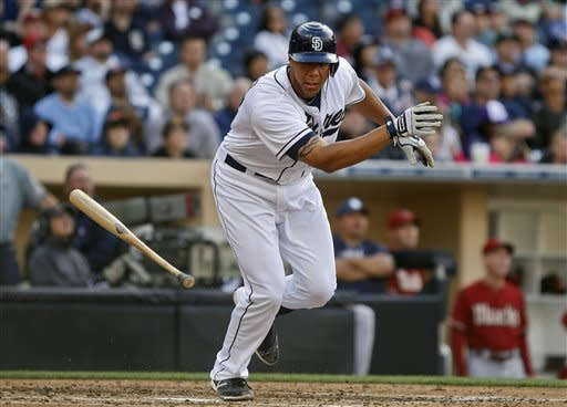 San Diego Padres' Kyle Blanks tosses his bat as he flies out to right with two runners on-base to end the fourth inning threat against the Arizona Diamondbacks in a baseball game on Wednesday, April 11, 2012, in San Diego. (AP Photo/Lenny Ignelzi)