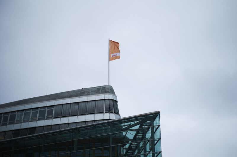 A flag of Germany's Christian Democratic Union party, CDU, the party of Chancellor Angela Merkel, waves in the wind on top of the party's headquarters in Berlin
