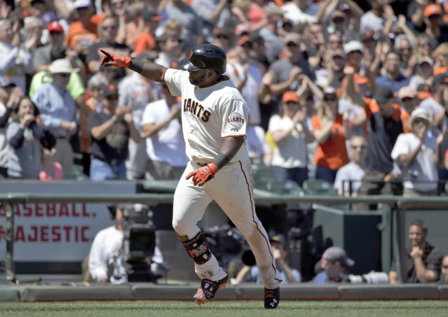 San Francisco Giants' Pablo Sandoval celebrates as he rounds the bases after his solo home run against the Miami Marlins during the fifth inning of a baseball game on Sunday, May 18, 2014, in San Francisco. (AP Photo/Marcio Jose Sanchez)