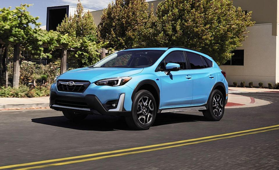 """<p>The <a href=""""https://www.caranddriver.com/subaru/crosstrek"""" rel=""""nofollow noopener"""" target=""""_blank"""" data-ylk=""""slk:Subaru Crosstrek"""" class=""""link rapid-noclick-resp"""">Subaru Crosstrek</a> Hybrid is an impressive fuel-sipper with an EPA-estimated 90 MPGe combined mileage. This little hybrid goes far, and it's one of the safest subcompact crossovers for sale today. The Crosstrek earned Good and Superior <a href=""""https://www.iihs.org/ratings/vehicle/subaru/crosstrek-hybrid-4-door-wagon/2021"""" rel=""""nofollow noopener"""" target=""""_blank"""" data-ylk=""""slk:IIHS ratings in every test"""" class=""""link rapid-noclick-resp"""">IIHS ratings in every test</a>. With an extra credit given for easy-to-access child-seat anchors. The model is so closely related to the Subaru Impreza sedan and hatchback that both models share the same ratings. We crashed our long-term Subaru Impreza hatchback during our last visit to an<a href=""""https://www.caranddriver.com/features/a24511826/safety-features-automatic-braking-system-tested-explained/"""" rel=""""nofollow noopener"""" target=""""_blank"""" data-ylk=""""slk:IIHS testing facility."""" class=""""link rapid-noclick-resp""""> IIHS testing facility.</a> Of the four cars we tested, it was the only vehicle to avoid a collision using its EyeSight Driver Assist at 45 mph. The <a href=""""http://caranddriver.com/cadillac/ct6"""" rel=""""nofollow noopener"""" target=""""_blank"""" data-ylk=""""slk:Cadillac CT6"""" class=""""link rapid-noclick-resp"""">Cadillac CT6</a>, <a href=""""https://www.caranddriver.com/tesla/model-s"""" rel=""""nofollow noopener"""" target=""""_blank"""" data-ylk=""""slk:Tesla Model S"""" class=""""link rapid-noclick-resp"""">Tesla Model S</a>, and <a href=""""https://www.caranddriver.com/toyota/camry"""" rel=""""nofollow noopener"""" target=""""_blank"""" data-ylk=""""slk:Toyota Camry"""" class=""""link rapid-noclick-resp"""">Toyota Camry</a> all hit the target at lower speeds. The Crosstrek Hybrid is the most expensive version of the model, and as such includes a bunch of safety features optional in lower trims. Every Crosstrek Hybrid has EyeSight Drive"""