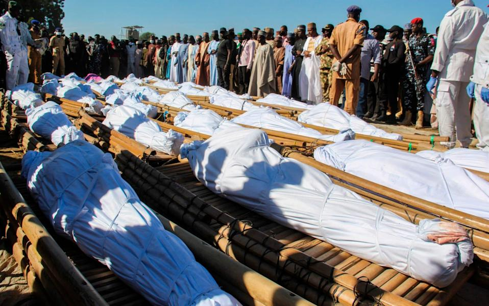 Mourners attend the funeral of 43 farm workers in Zabarmari, Nigeria - AUDU MARTE/AFP