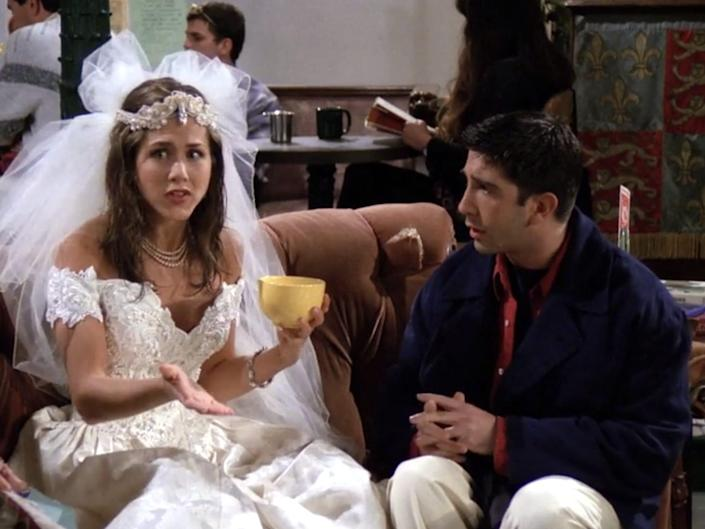 """Jennifer Aniston and David Schwimmer sitting on a couch on the series premiere of """"Friends."""""""