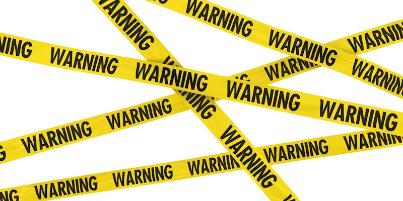 Lots of criss-crossing yellow tale is shown, on which is preinted, repeatedly, the word warning.