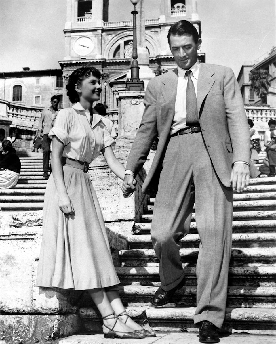 """<p>If the beach doesn't quite do it for you, curl up with this Audrey Hepburn rom-com classic, filmed on location in Rome, about an undercover princess who spends a day touring all of the city's stunning sights with a Gregory Peck. It's best served with pasta, of course. </p> <p><em>Available to rent on</em> <a href=""""https://itunes.apple.com/us/movie/roman-holiday/id215743781"""" rel=""""nofollow noopener"""" target=""""_blank"""" data-ylk=""""slk:iTunes"""" class=""""link rapid-noclick-resp""""><em>iTunes</em></a><em>.</em></p>"""