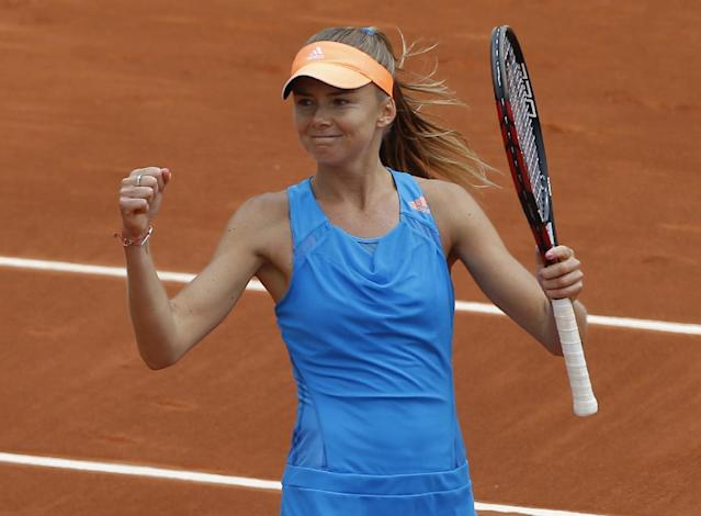 Slovakia's Daniela Hantuchova reacts after defeating Serbia's Jovana Jaksic in the first round match of the French Open tennis tournament at the Roland Garros stadium, in Paris, France, Sunday, May 25, 2014. (AP Photo/Michel Spingler)