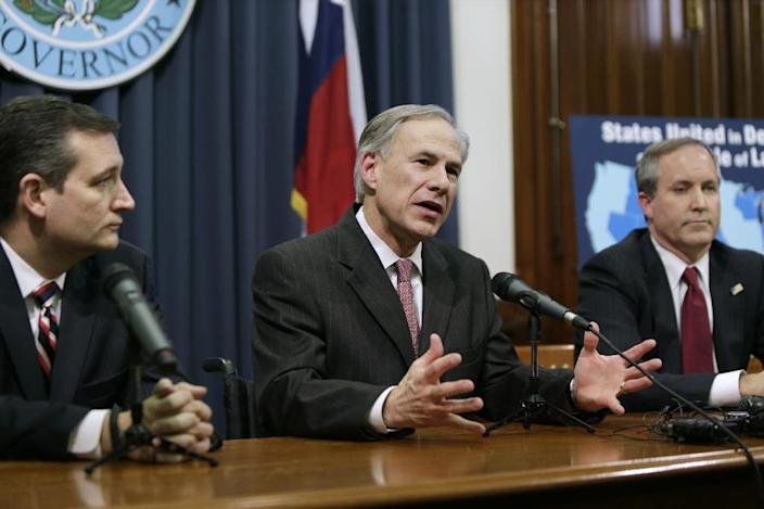 Governor Greg Abbott (C) speaks alongside Senator Ted Cruz (L) and Attorney General Ken Paxton on February 18, 2015 about the lawsuit filed by a Texas-led coalition of 26 states challenging President Obama's executive action on immigration (AFP Photo/Erich Schlegel)