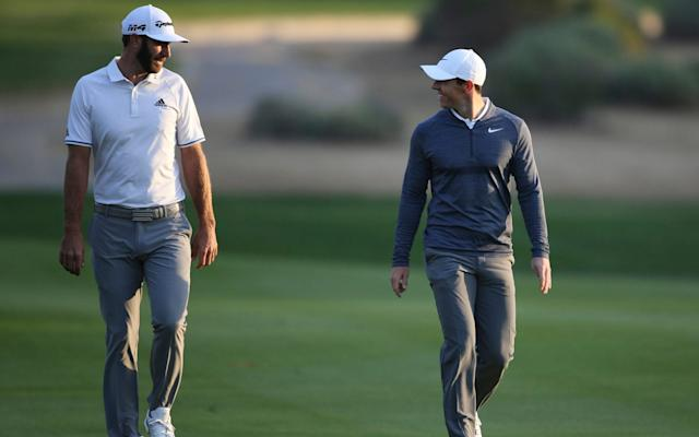 Dustin Johnson and Rory McIlroy - AP