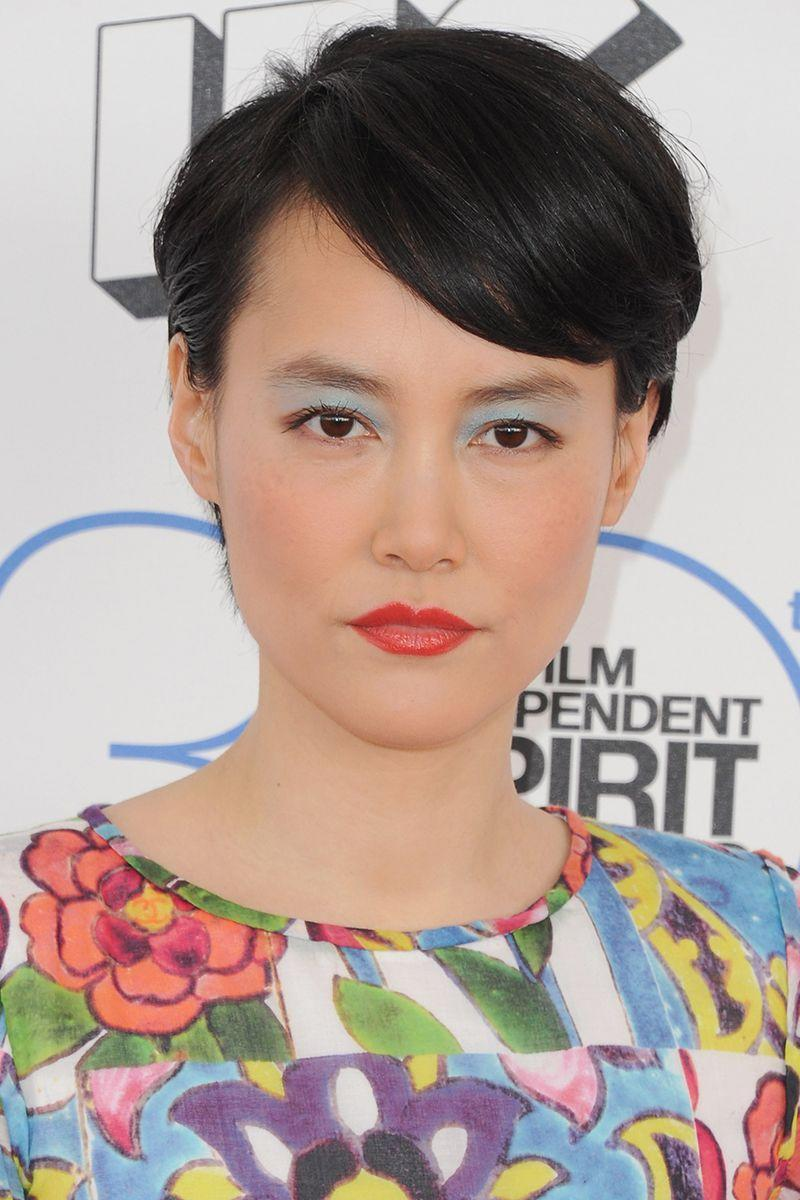 <p>Actress Rinko Kikuchi wears her pixie cut with side swept bangs for a softer pixie look that we love. </p>