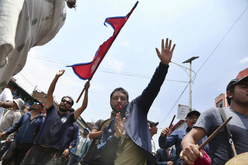 Nepalese Newar community members shout slogans during a protest against government in Kathmandu, Nepal, Wednesday, June 19, 2019. Thousands of people protested in the Nepalese capital to protest a Bill that would give government control over community and religious trusts. Protesters demanded the government scrap the proposed Bill to protect these trusts that hold religious ceremonies and festivals. (AP Photo/Niranjan Shrestha)