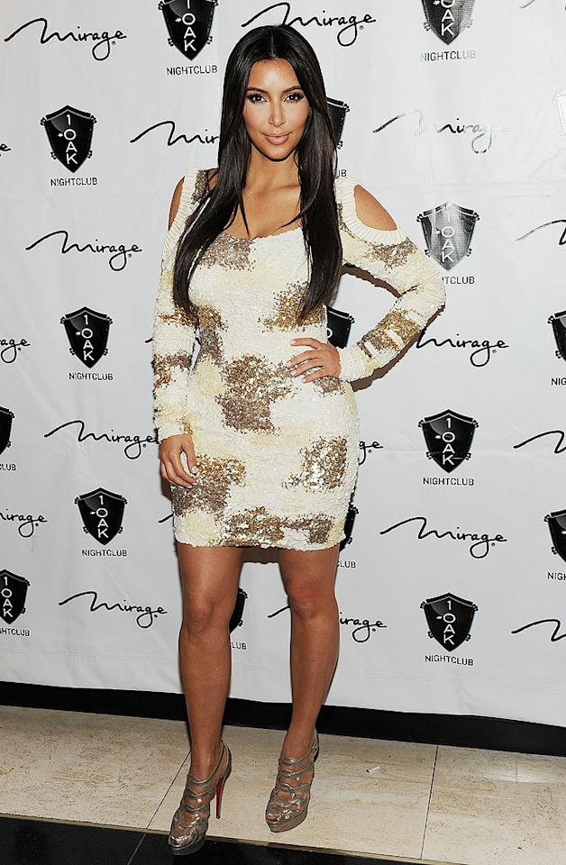 "Call us crazy, but we actually think Kim Kardashian looked better <a target=""_blank"" href=""http://omg.yahoo.com/photos/celebrities-get-attacked-slideshow/"">covered in flour</a> than she did in this gaudy mess of a dress she donned for little brother Rob's recent birthday bash. (3/16/2012)"