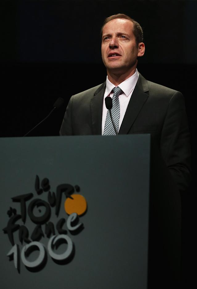 PARIS, FRANCE - OCTOBER 24: Tour de France Director Christian Prudhomme addresses the audience at the 2013 Tour de France Route Presentation at the Palais des Congres de Paris on October 24, 2012 in Paris, France. (Photo by Bryn Lennon/Getty Images)