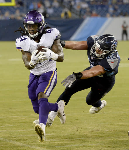 Minnesota Vikings running back Mike Boone (44) is pushed out of bounds by Tennessee Titans linebacker Robert Spillane (42) in the second half of a preseason NFL football game Thursday, Aug. 30, 2018, in Nashville, Tenn. (AP Photo/Mark Zaleski)