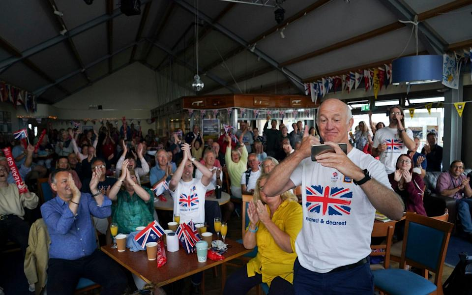 Mike McIntyre celebrates at Hayling Island Sailing Club after his daughter Eilidh and Hannah Mills won Olympic gold - PA