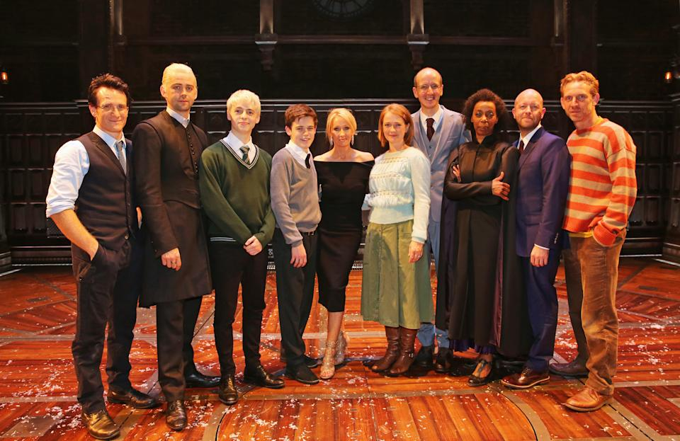 """LONDON, ENGLAND - JULY 30:  (L to R) Jamie Parker, Alex Price, Anthony Boyle, Sam Clemmett, J.K. Rowling, Poppy Miller, Jack Thorne, Noma Dumezweni, director John Tiffany and Paul Thornley attends the press preview of """"Harry Potter & The Cursed Child"""" at The Palace Theatre on July 30, 2016 in London, England.  (Photo by David M. Benett/Dave Benett/Getty Images)"""