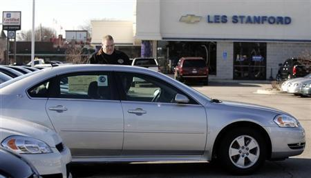 A customer looks at a 2009 Chevrolet Impala sedan at a dealership in Dearborn, Michigan