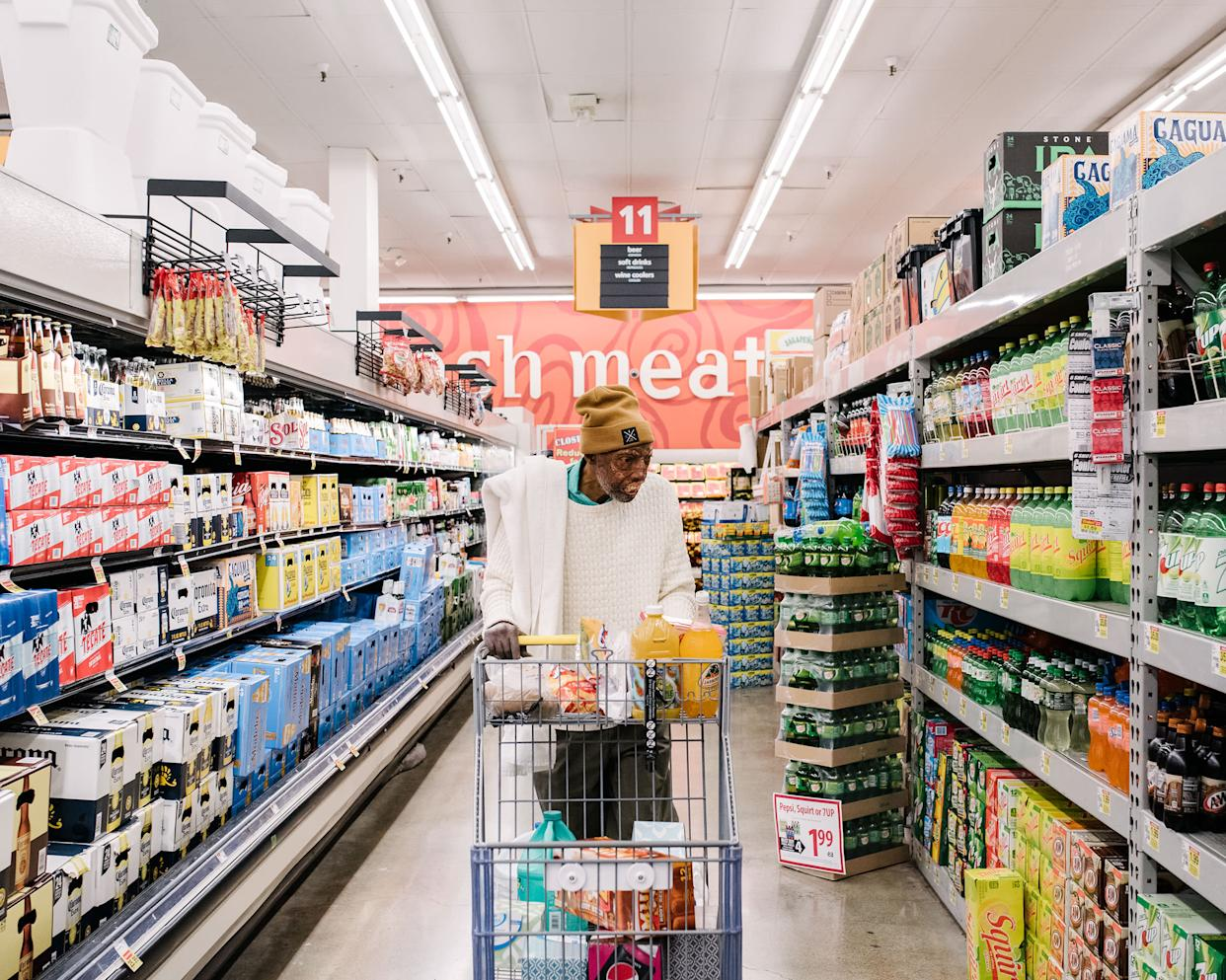 Robert Chelsea shops for groceries at a local market near a friend's apartment where he was temporarily staying in Los Angeles in February 2019 | John Francis Peters for TIME