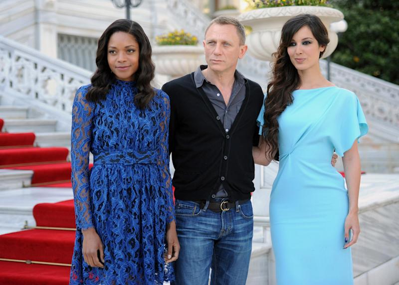 From left, British actors Naomie Harris, Daniel Craig and French actress Berenice Marlohe arrive for the photo call of the 23rd film in the James Bond series, 'Skyfall', in Istanbul, Turkey, Sunday, April 29, 2012. (AP Photo )