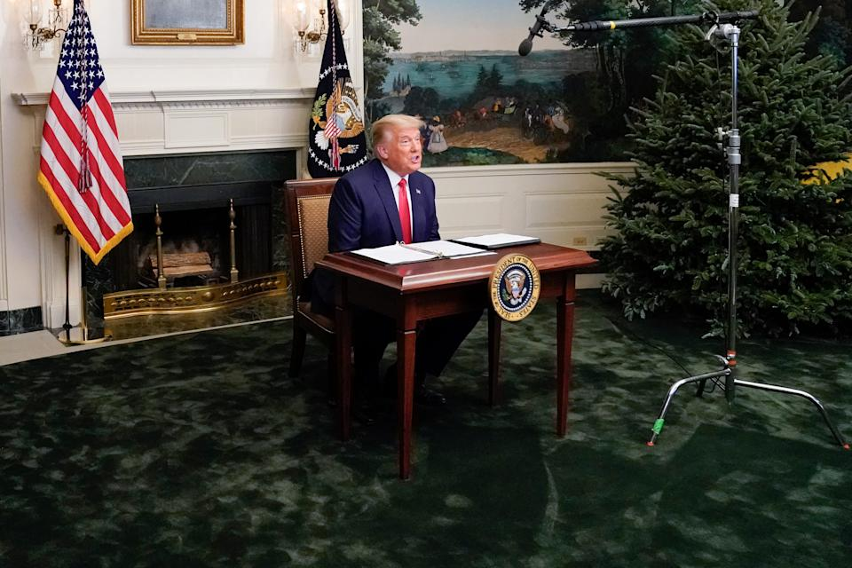 U.S. President Donald Trump participates in a Thanksgiving video teleconference with members of the military forces at the White House in Washington, U.S., November 26, 2020.