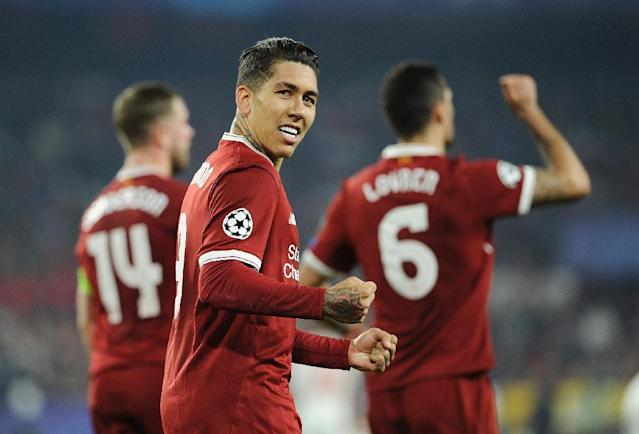 Liverpool's midfielder Roberto Firmino celebrates after scoring a goal on November 21, 2017 during the UEFA Champions League group E football match against Sevilla FC (AFP Photo/CRISTINA QUICLER )