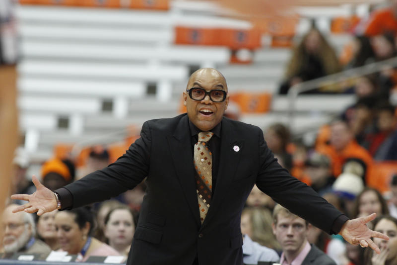 Syracuse head coach Quentin Hillsman yells to his players in the first quarter of an NCAA college basketball game against Louisville in Syracuse, N.Y., Sunday, Feb. 9, 2020. (AP Photo/Nick Lisi)