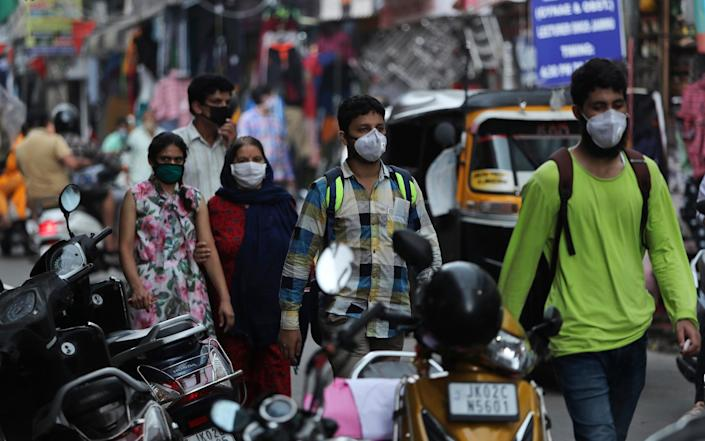 Indians wearing face masks at a market in Jammu, India - AP