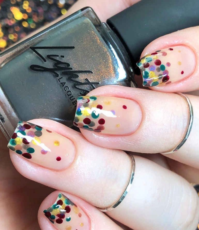 "<p>Adding in colored dots (including red and green!) on top of a base coat—like <a href=""https://www.instagram.com/miasolx/"" rel=""nofollow noopener"" target=""_blank"" data-ylk=""slk:Brooklyn, NY based nail blogger Mia"" class=""link rapid-noclick-resp"">Brooklyn, NY based nail blogger Mia</a> did here—creates a celebratory manicure that's easy to replicate at home with the right tool.</p><p><a class=""link rapid-noclick-resp"" href=""https://www.amazon.com/JSDOIN-Dotting-Tool-Paint-Manicure/dp/B07GBS9WLX/?tag=syn-yahoo-20&ascsubtag=%5Bartid%7C10072.g.34113691%5Bsrc%7Cyahoo-us"" rel=""nofollow noopener"" target=""_blank"" data-ylk=""slk:SHOP NAIL DOT TOOL"">SHOP NAIL DOT TOOL</a></p>"