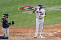 New York Mets' Yoenis Cespedes, right, celebrates his solo home run during the seventh inning of a baseball game against the Atlanta Braves at Citi Field, Friday, July 24, 2020, in New York. (AP Photo/Seth Wenig)