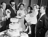 """<p>Sammy Davis, Jr., is joined by his fellow """"Rat Pack"""" friends as he and his first wife say """"I do."""" The couple held their small ceremony at the Sands Hotel in Las Vegas, but were sadly divorced less than a year later. </p>"""