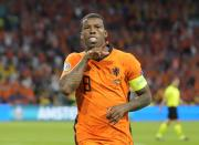 Georginio Wijnaldum of the Netherlands celebrates after scoring his side's opening goal during the Euro 2020 soccer championship group C match between the Netherlands and Ukraine at the Johan Cruijff Arena in Amsterdam, Netherlands, Sunday, June 13, 2021. (AP Photo/Peter Dejong, Pool)