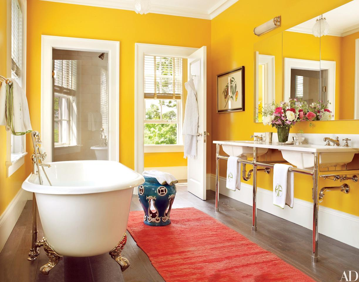 "In the sunny master bath of designer Katie Ridder and architect Peter Pennoyer's getaway in New York's <a rel=""nofollow"" href=""https://www.architecturaldigest.com/story/peter-pennoyer-katie-ridder-hudson-valley-home-article?mbid=synd_yahoo_rss"">Hudson Valley</a>, Robern medicine cabinets are mounted over a washstand equipped with Waterworks sinks and fittings."