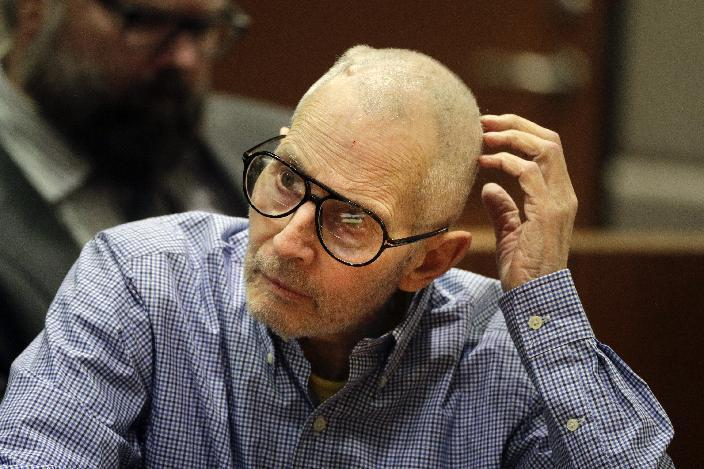 FILE - In this Dec. 21, 2016 file photo, real estate heir Robert Durst sits in a courtroom during a hearing in Los Angeles. Before a judge even decides if there's enough evidence to try Durst on an old murder charge, prosecutors plan to start taking testimony. In a rare hearing Tuesday, Feb. 13, two witnesses will be called to the witness stand against Durst in Los Angeles Superior Court to preserve their testimony in case it is needed later.(AP Photo/Jae C. Hong, Pool, File)