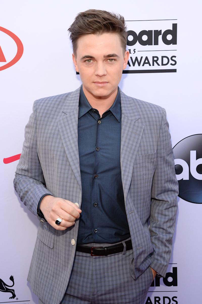 A photo of recording artist Jesse McCartney wearing a grey suit and navy shirt at the 2015 Billboard Music Awards at MGM Grand Garden Arena on May 17, 2015 in Las Vegas, Nevada.