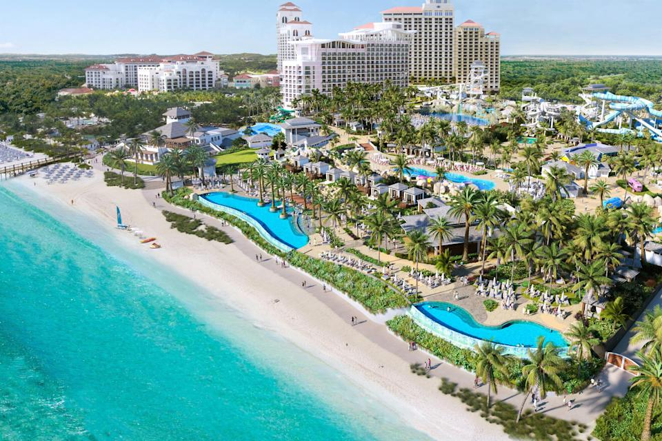 """The Bahamas is <a href=""""https://www.cntraveler.com/story/a-guide-to-the-caribbean-islands-reopening-this-summer?mbid=synd_yahoo_rss"""" rel=""""nofollow noopener"""" target=""""_blank"""" data-ylk=""""slk:currently open"""" class=""""link rapid-noclick-resp"""">currently open</a> to all travelers with no quarantine requirements (although unvaccinated folks will need to take a COVID-19 test upon entry), so we're ready to pay a visit—especially knowing how much the country relies on tourism dollars. More than 700 islands and thousands of deserted cays make up this sprawling island nation, barely 60 miles east of Florida. When you aren't sprawled out on the sand, be sure to check out the brand-new waterpark at Nassau's Baha Mar Resort, Baha Bay, which opens to hotel guests on July 2. Set on 15 beachfront acres, Baha Bay will feature 24 water slides, a 500,000-gallon wave pool, and a surf simulator, plus an array of restaurants and an outdoor casino. Even if you aren't typically a fan of waterparks, you must admit that sounds pretty awesome."""