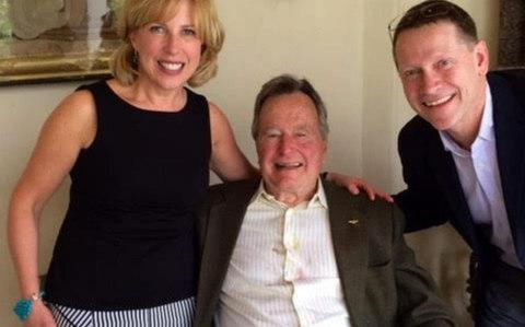 "Christina Baker Kline, a British-born novelist, claims Mr Bush put his arm around her as they posed for a photograph before dropping his hand to squeeze her ""butt"""