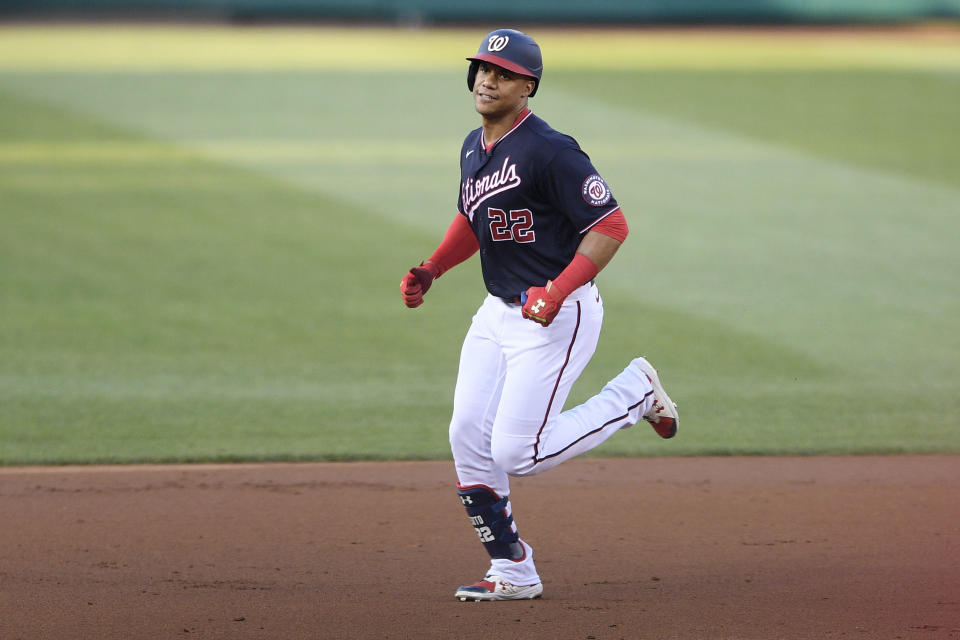 Washington Nationals' Juan Soto rounds the bases on his three-run home run during the first inning of a baseball game against the San Diego Padres, Friday, July 16, 2021, in Washington. (AP Photo/Nick Wass)