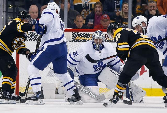 Boston Bruins' Patrice Bergeron (37) tries to shoot against Toronto Maple Leafs' Frederik Andersen (31), of Denmark, during the first period of Game 5 of an NHL hockey first-round playoff series in Boston, Saturday, April 21, 2018. (AP Photo/Michael Dwyer)