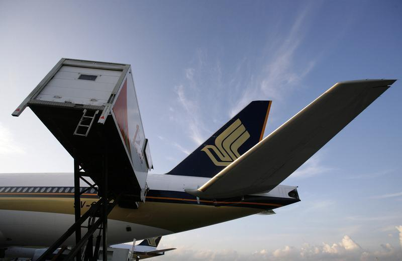 Catering truck parks next to Singapore Airlines aircraft at Changi Airport in Singapore
