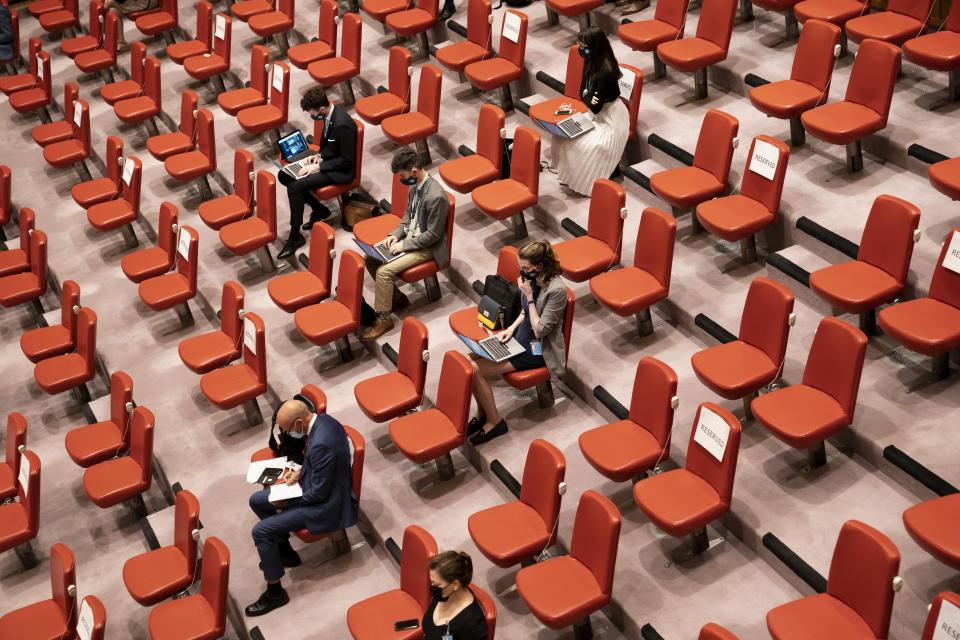Seats remain empty in the press gallery as COVID-19 prevention protocols are observed during a meeting of the United Nations Security Council, Thursday, Sept. 23, 2021, during the 76th Session of the U.N. General Assembly in New York. (AP Photo/John Minchillo, Pool)