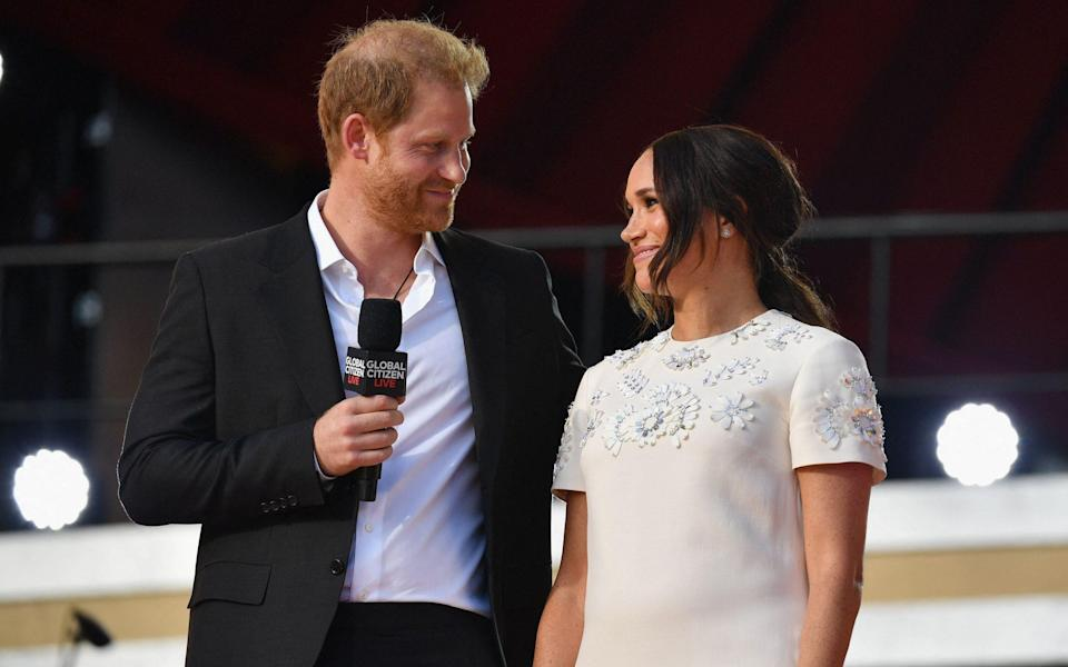 Meghan wore a white Valentino dress to present at Global Citizen Live - Wireimage