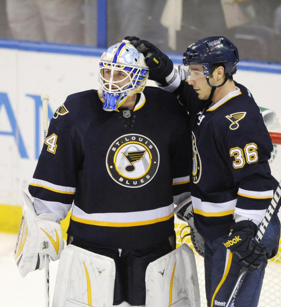 St. Louis Blues' goalie Jake Allen (34) is congratulated by teammate Matt D'Agostini (36) after his shutout over the Phoenix Coyotes in an NHL hockey game on Thursday, March 14, 2013, in St. Louis. The Blues won 3-0. (AP Photo/Bill Boyce)