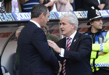 Britain Soccer Football - Swansea City v Stoke City - Premier League - Liberty Stadium - 22/4/17 Swansea City manager Paul Clement shakes hands with Stoke City manager Mark Hughes before the match Reuters / Rebecca Naden Livepic