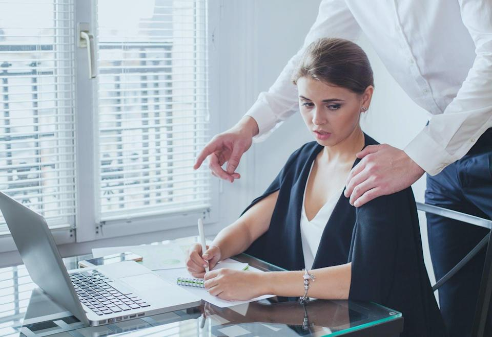 "<span class=""caption"">Unwanted touching in the office is an all-too-common experience for women.</span> <span class=""attribution""><a class=""link rapid-noclick-resp"" href=""https://www.gettyimages.com/detail/photo/sexual-harassment-at-work-royalty-free-image/1216847792"" rel=""nofollow noopener"" target=""_blank"" data-ylk=""slk:anyaberkutiStock via Getty Images"">anyaberkutiStock via Getty Images</a></span>"