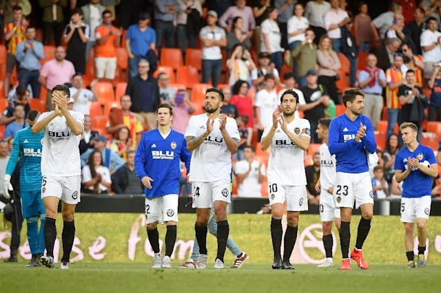 Valencia's win over Alaves put them in pole position to snatch the final Champions League spot in Spain (AFP Photo/JOSE JORDAN)