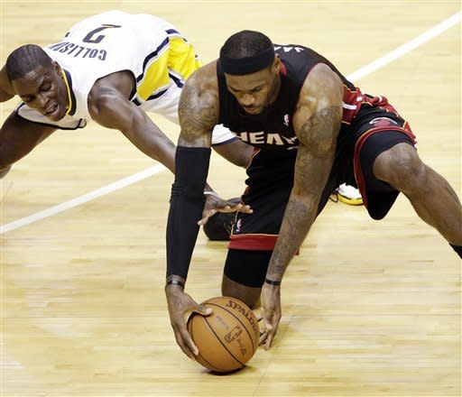 Miami Heat forward LeBron James, right, picks up a loose ball in front of Indiana Pacers guard Darren Collison (2) during the second half of Game 4 of their NBA basketball Eastern Conference semifinal playoff series, Sunday, May 20, 2012, in Indianapolis. The Heat won 101-93. (AP Photo/AJ Mast)